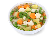 Vegetable soup meal with vegetables in bowl isolated. Vegetable soup meal with vegetables, potatoes, carrots and peas in bowl isolated on a white background Royalty Free Stock Photography