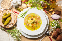 Vegetable soup on parchment. Vegetable soup in wooden bowl and ingredients on parchment Royalty Free Stock Image