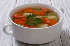 Vegetable soup with peas, onions, carrots, potatoes Stock Photography