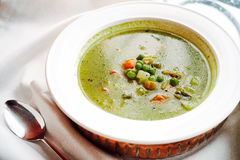Vegetable soup with peas royalty free stock photography