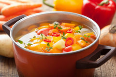 Vegetable soup in pot. Vegetable soup in red pot Stock Image