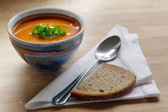 Vegetable soup in a pottery bowl, bread and spoon Stock Photo