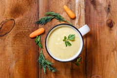 Vegetable soup puree in a mug royalty free stock photo