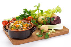 Vegetable soup and raw vegetables Royalty Free Stock Images