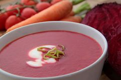 Vegetable soup with red beet, carrots and tomatoes. Red beet soup with carrots and tomatoes. Served with cream and leek Stock Photos