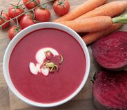 Vegetable soup with red beet, carrots and tomatoes. Red beet soup with carrots and tomatoes. Served with cream and leek Stock Photography