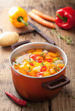 Vegetable soup in red pot Stock Photography