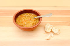 Vegetable soup with remainder of bread roll Royalty Free Stock Photography