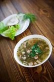 Vegetable soup with sausages in a plate Stock Images
