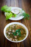 Vegetable soup with sausages in a plate Stock Photos