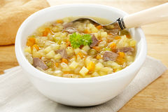 Vegetable Soup Scotch Broth. A bowl of bubbling hot Scotch Broth or Vegetable Soup, made from lamb shank, potato,carrot,celery,dried peas and pearl barley Royalty Free Stock Images