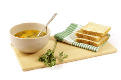 Vegetable soup with sliced bread Stock Photo