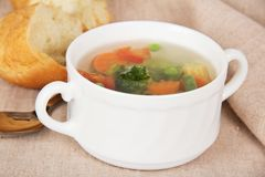 Vegetable soup, slices of bread and spoon Royalty Free Stock Photos
