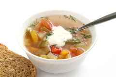 Vegetable soup with sour cream and bread Stock Photos