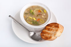 Vegetable soup and toasted bread Stock Image