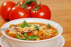 Vegetable soup with tomato in the background Royalty Free Stock Photos