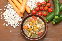 Vegetable soup, typical Italian soup with tomatoes, zucchini, po Royalty Free Stock Photography