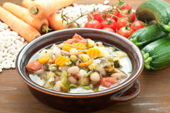 Vegetable soup, typical Italian soup with tomatoes, zucchini, po Stock Image