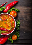 Vegetable soup um red pepper and tomatoes with green peas. Top view , food background Royalty Free Stock Images