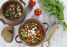 Vegetable soup with white beans stock image