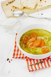 Vegetable soup in a white bowl. On a wooden background Royalty Free Stock Images