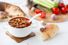 Vegetable soup in white bowl on wooden table Stock Images