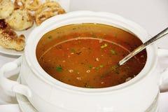 Vegetable soup in white ceramic bowl, food scene Royalty Free Stock Photo