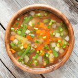 Vegetable soup in wooden bow Royalty Free Stock Images