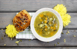 Vegetable soup on wooden table Stock Photos