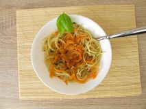 Vegetable spaghetti from carrots and spaghetti in broth Royalty Free Stock Photography