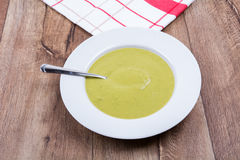 Vegetable split pea soup on a wooden background Stock Images