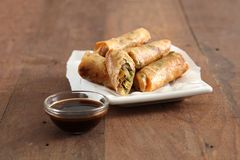 Vegetable spring roll. Fried vegetable spring rolls on wooden background Royalty Free Stock Image