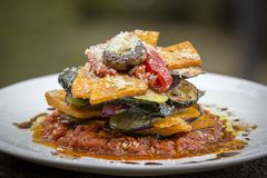 Vegetable stack - pumpkin, zucchini, red capsicum, eggplant and mushroom cooked in a tomato, onion, and garlic sauce topped with p. Armesan cheese . Close up stock images