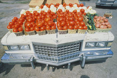 Vegetable stand situated on top of Cadillac Royalty Free Stock Image