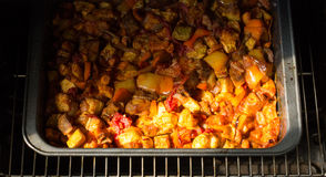 Vegetable stew cooked in the oven. Juicy vegetable stew cooked in the oven Royalty Free Stock Photos