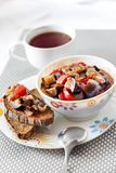 Vegetable stew with eggplant, red pepper and tomatoes. On toasted rye bread royalty free stock images