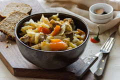 Vegetable stew with meat and potato. Bread Royalty Free Stock Photo