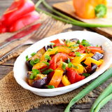 Vegetable stew on a plate. Vegetarian stew with braised eggplant, mixed peppers and green onions. Vegetable mix. Healthy food Royalty Free Stock Image