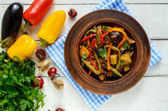 Vegetable stew salad: bell pepper, eggplant, asparagus beans, garlic, carrot, leek. Bright spicy aromatic dishes Stock Photos