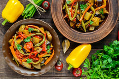 Vegetable stew salad: bell pepper, eggplant, asparagus beans, garlic, carrot, leek. Bright spicy aromatic dishes Stock Images