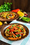 Vegetable stew salad: bell pepper, eggplant, asparagus beans, garlic, carrot, leek. Bright spicy aromatic dishes. Royalty Free Stock Photos