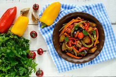 Vegetable stew salad: bell pepper, eggplant, asparagus beans, garlic, carrot, leek. Bright spicy aromatic dishes. Royalty Free Stock Image