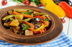 Vegetable stew salad: bell pepper, eggplant, asparagus beans, garlic, carrot, leek. Bright spicy aromatic dishes. Stock Photo