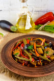 Vegetable stew salad: bell pepper, eggplant, asparagus beans, garlic, carrot, leek. Bright spicy aromatic dishes Royalty Free Stock Photos