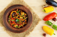 Vegetable stew salad: bell pepper, eggplant, asparagus beans, garlic, carrot, leek. Bright spicy aromatic dishes. Royalty Free Stock Images