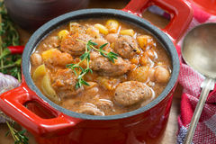 Vegetable stew with sausages in a pan, close-up Royalty Free Stock Photography