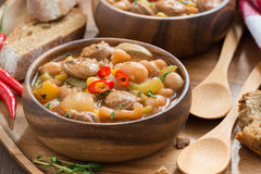 Vegetable stew with sausages in a wooden bowl Royalty Free Stock Photo