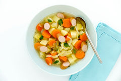 Vegetable Stew with Sliced Sausage in Blue Soup Bowl Stock Images