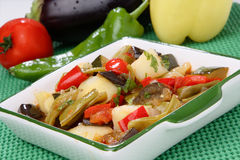 Vegetable stew in white bowl. On plate Stock Photos