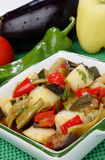 Vegetable stew in white bowl. On plate Royalty Free Stock Photo